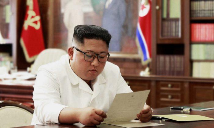 Korean leader Kim Jong Un reads a letter from President Donald Trump, on June 23,2019. (Korean Central News Agency/Korea News Service via AP, File)