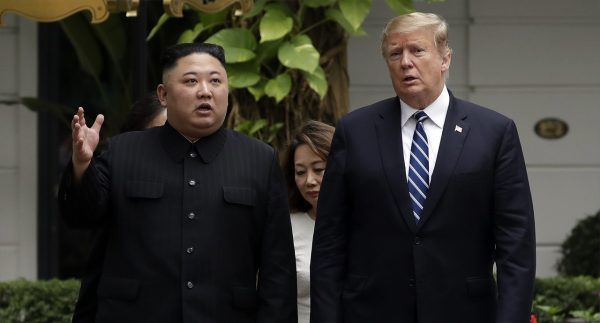 President Donald Trump and North Korean leader Kim Jong Un take a walk