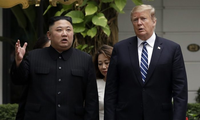 President Donald Trump and North Korean leader Kim Jong Un take a walk after their first meeting at the Sofitel Legend Metropole Hanoi hotel, in Hanoi, Vietnam, on June 23, 2019. (Evan Vucci/AP Photo)