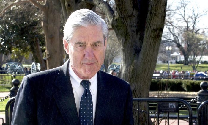 Robert Mueller walks past the White House on March 24, 2019. (Cliff Owen/AP Photo)