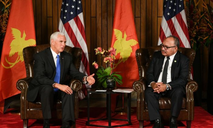 U.S. Vice President Mike Pence (L) speaks next to Papua New Guinea's Prime Minister Peter O'Neill during their bilateral meeting on the sidelines of the Asia-Pacific Economic Cooperation (APEC) Summit, in Port Moresby on Nov. 17, 2018.  (Saeed Khan/AFP/Getty Images)