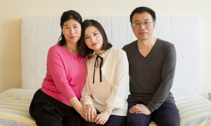 (L–R) Wang Huijuan, Li Fuyao, and Li Zhenjun at their home in Queens, New York, on Jan. 8, 2017. The family escaped China in 2014 and were granted asylum after enduring years of torture for practising Falun Gong. (Samira Bouaou/Epoch Times)