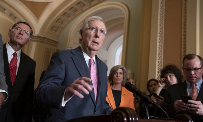 Senate Majority Leader Mitch McConnell (R-Ky.) joined at left by Sen. John Barrasso (R-Wyo.) and Sen. Joni Ernst (R-Iowa) right, speaks to reporters following the Republican Conference luncheon, at the Capitol in Washington on June 25, 2019. (J. Scott Applewhite/AP Photo)