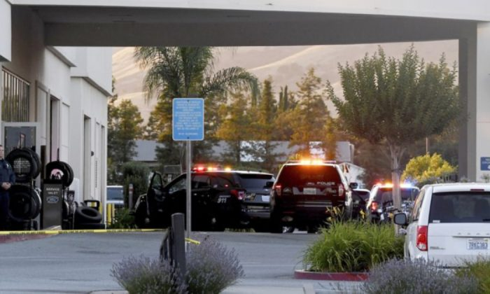 Police investigate the scene of a shooting at the Morgan Hill Ford Store in Morgan Hill, Calif., on June 25, 2019. (AP Photo/Nic Coury)