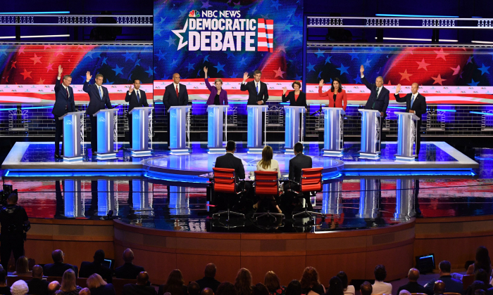 Democratic presidential hopefuls (from L) Bill de Blasio, Tim Ryan, Julian Castro, Cory Booker, Elizabeth Warren, Beto O'Rourke, Amy Klobuchar, Tulsi Gabbard, Jay Inslee, and John Delaney  participate in the first Democratic primary debate of the 2020 presidential campaign season hosted by NBC News on June 26, 2019. (Jim Watson/AFP/Getty Images)