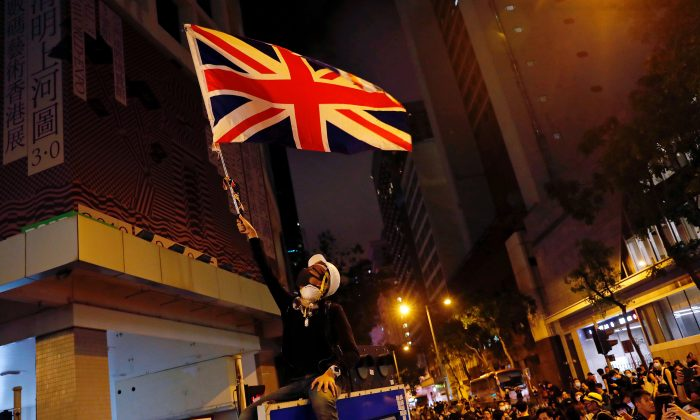 A demonstrator waves Union Flag during a demonstration outside police headquarters, demanding Hong Kong's leaders to step down and withdraw the extradition bill, in Hong Kong, China on June 27, 2019. (Tyrone Siu/Reuters)