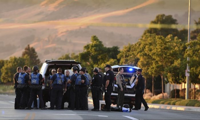 Police investigate at the scene of a shooting at the Morgan Hill Ford Store in Morgan Hill, Calif., on June 25, 2019. (Nic Coury/AP Photo)