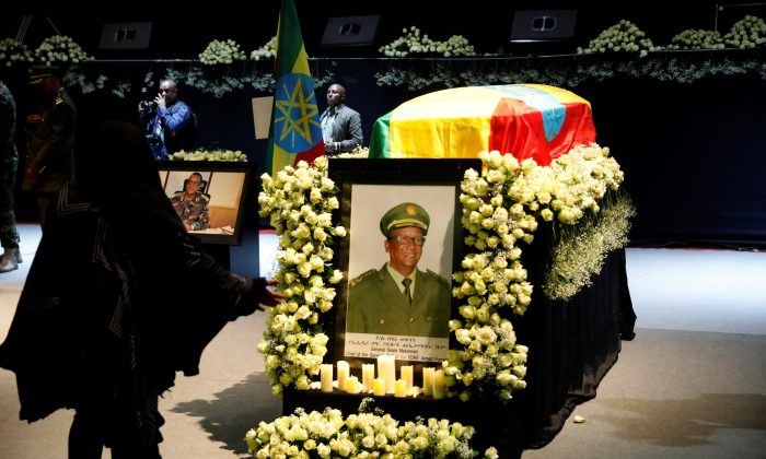 A mourner stands in front of the coffin of Army Chief of Staff Seare Mekonnen, who was shot by his bodyguard, during a memorial ceremony in Addis Ababa, Ethiopia June 25, 2019. (Baz Ratner/Reuters)