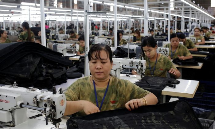 Workers assemble products at a factory owned by Yakeda Outdoor Travel Products Co in Yangon, Burma on June 11, 2019. (Ann Wang/Reuters)