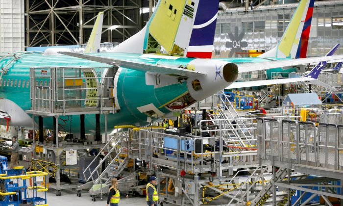Employees walk by the end of a 737 Max aircraft at the Boeing factory in Renton, Washington, U.S., on March 27, 2019.  (Reuters/Lindsey Wasson/File Photo)