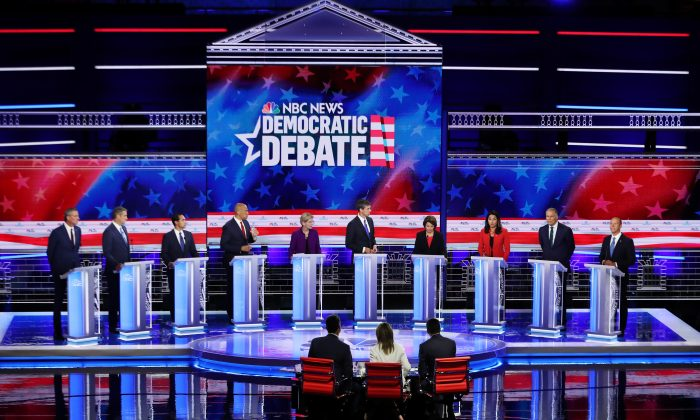 Democratic presidential candidates New York City Mayor Bill De Blasio (L-R), Rep. Tim Ryan (D-OH), former housing secretary Julian Castro, Sen. Cory Booker (D-NJ), Sen. Elizabeth Warren (D-MA), former Texas congressman Beto O'Rourke, Sen. Amy Klobuchar (D-MN), Rep. Tulsi Gabbard (D-HI), Washington Gov. Jay Inslee, and former Maryland congressman John Delaney take part in the first night of the Democratic presidential debate in Miami, Florida on June 26, 2019. (Joe Raedle/Getty Images)