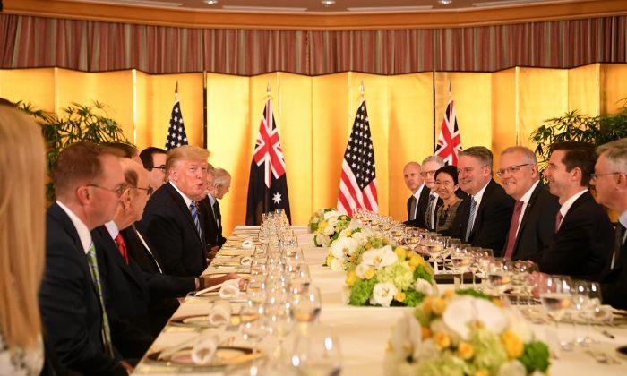 U.S. President Donald Trump and Australian Prime Minister Scott Morrison speak during a working dinner ahead of the official start of the G20 summit in Osaka, Japan, on June 27, 2019. (AAP Image/Lukas Coch)
