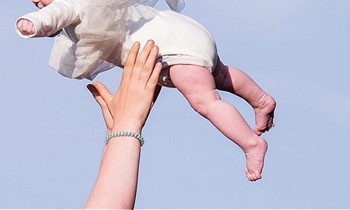 Stock image of a person catching a child. (Pixelwunder By Rebecca/Pixabay)