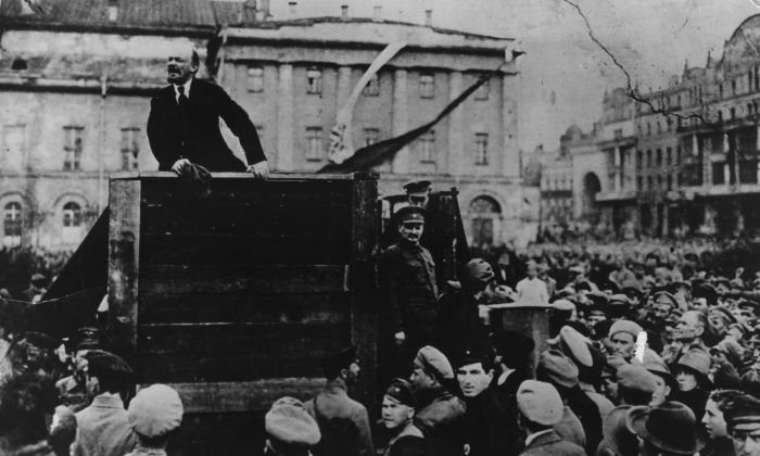 Russian communist revolutionary leader, Vladimir Lenin (1879 - 1924), giving a speech in to men of the Red Army leaving for the front, during the Polish-Soviet War, Sverdlov Square (now Theatre Square), Moscow, 5th May 1920. On the right of the platform are People's Commissar Leon Trotsky (1879 - 1940) and Politburo member Lev Kamenev (1883 - 1936). (Keystone/Getty Images)