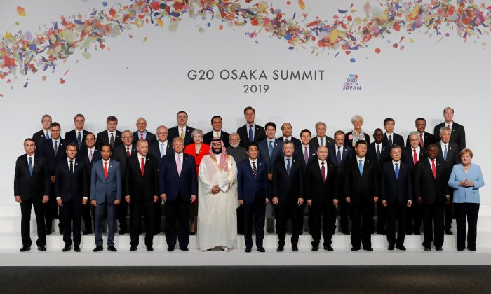 Japanese Prime Minister Shinzo Abe, other leaders and delegates attend a family photo session at G20 leaders summit in Osaka, Japan on June 28, 2019. (Kim Kyung-Hoon/Poo via Getty Images)