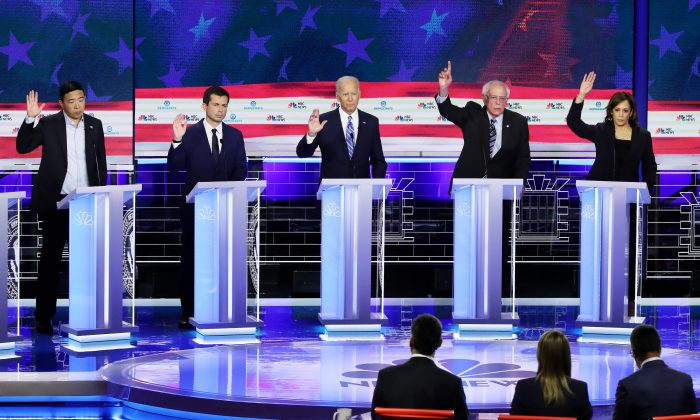Democratic presidential candidates (L-R) Andrew Yang, Pete Buttigieg, Joe Biden, Bernie Sanders, and Kamala Harris, during the second night of the first Democratic presidential debate in Miami, Florida, on June 27, 2019. (Drew Angerer/Getty Images)