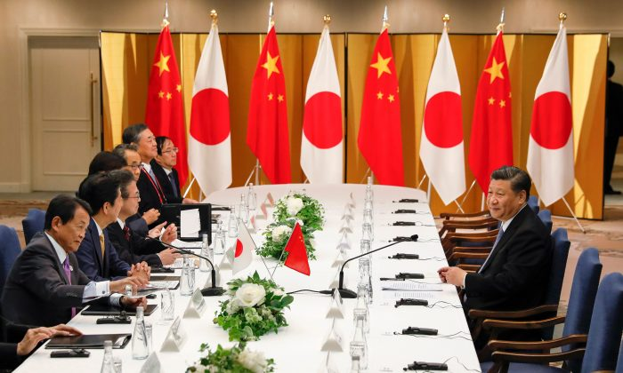Japanese Prime Minister Shinzo Abe (2nd L) and Chinese leader Xi Jinping (R) attend their talks in Osaka, on June 27, 2019, ahead of the G20 Osaka Summit. (Kimimasa Mayama/AFP/Getty Images)