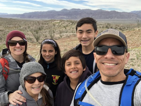 Smith hiking with his kids