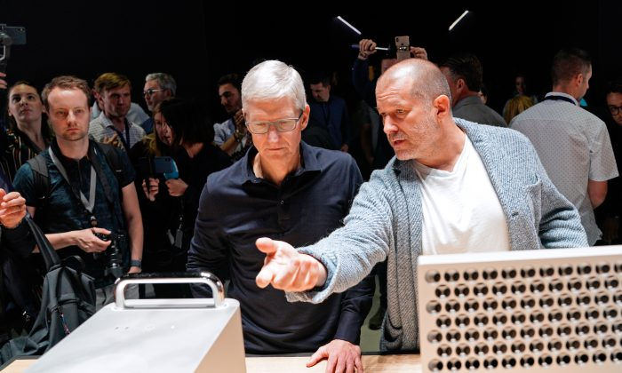 Apple CEO Tim Cook and Chief Design Officer Jonathan Ive (R) look over the new Mac Pro during Apple's annual Worldwide Developers Conference in San Jose, California, U.S. June 3, 2019. (Reuters/Mason Trinca)