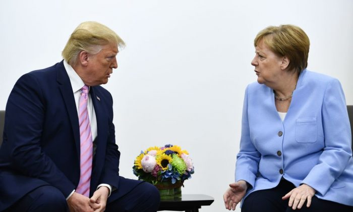 US President Donald Trump (L) attends a meeting with Germany's Chancellor Angela Merkel during the G20 Osaka Summit in Osaka on June 28, 2019. (BRENDAN SMIALOWSKI/AFP/Getty Images)