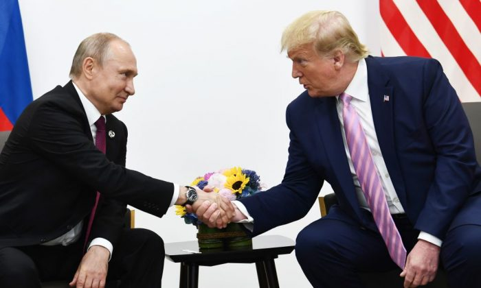 US President Donald Trump (R) attends a meeting with Russia's President Vladimir Putin during the G20 summit in Osaka on June 28, 2019. (BRENDAN SMIALOWSKI/AFP/Getty Images)