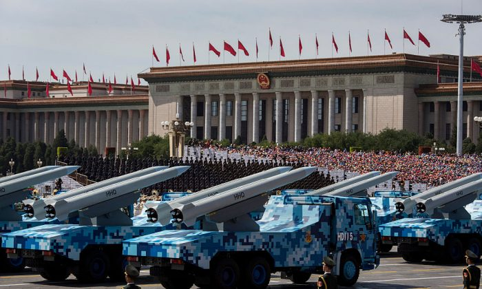 Chinese missiles are seen on trucks as they drive next to Tiananmen Square and the Great Hall of the People during a military parade in Beijing on Sept. 3, 2015. (Kevin Frayer/Getty Images)