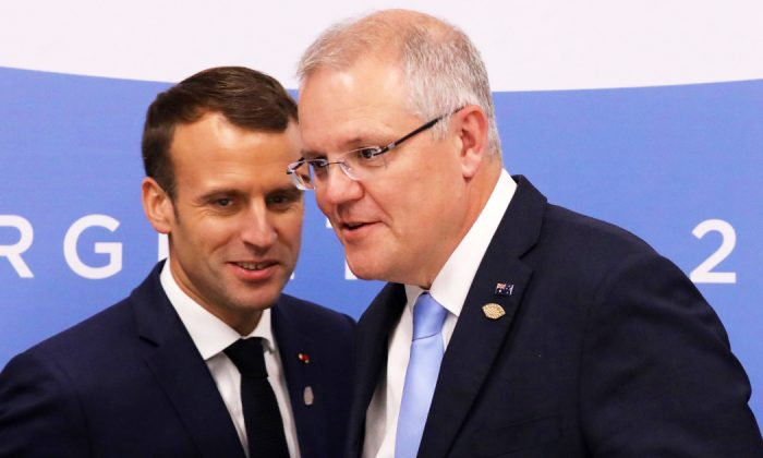 French President Emmanuel Macron (L) greets Australian Prime Minister Scott Morrison during the G20 Leaders' Summit in Buenos Aires on Nov. 30, 2018. (Ludovic Marin/AFP/Getty Images)