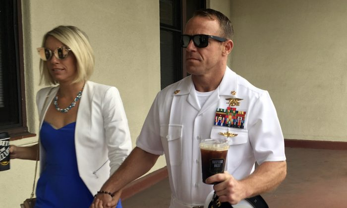 Navy Special Operations Chief Edward Gallagher (R) walks with his wife, Andrea Gallagher as they arrive to military court on Naval Base San Diego, in San Diego, Calif., on June 26, 2019.  (Julie Watson/AP Photo)