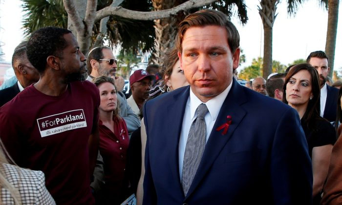 Florida Gov. Ron DeSantis arrives at a memorial service on the one-year anniversary of the shooting which claimed 17 lives at Marjory Stoneman Douglas High School in Parkland, Fla., on Feb. 14, 2019. (Joe Skipper/Reuters)