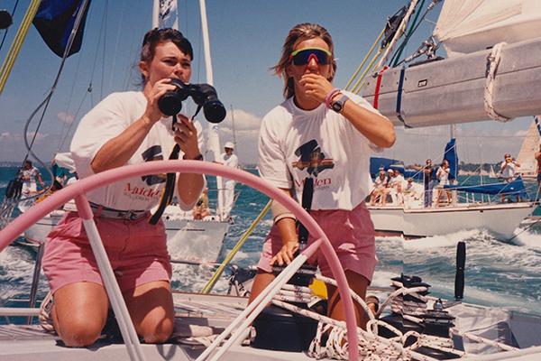 two women, binoculars, on boat