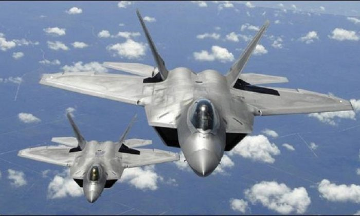 U.S. F-22 stealth jets intercepted four Russian bombers and two Russian Su-35 fighter jets off the coast of Alaska, according to a statement from North American Aerospace Defense Command, on May 20, 2019. (Sr Master Sgt ThomasMenegiun/DOD)