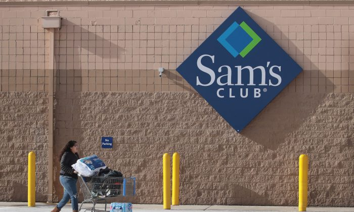 A shopper stocks up on merchandise at a Sam's Club store in Streamwood, Illinois, on Jan. 12, 2018. (Scott Olson/Getty Images)