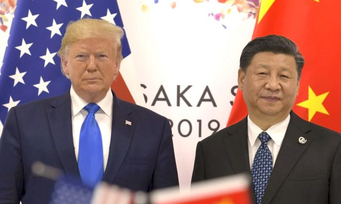 U.S. President Donald Trump (L) with Chinese leader Xi Jinping during a meeting on the sidelines of the G-20 summit in Osaka, Japan, on June 29, 2019. (AP Photo/Susan Walsh)