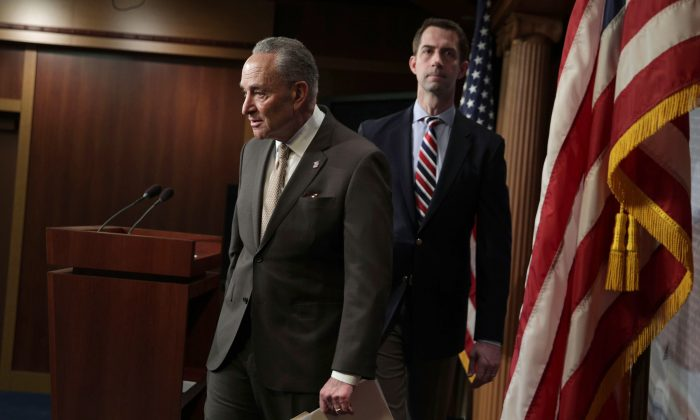 Sen. Tom Cotton (R-Ariz.) (R), and Senate Minority Leader Sen. Chuck Schumer (D-N.Y.) (L) after a news conference unveiling bipartisan legislation aimed at regulating the trafficking of fentanyl into the United State at the U.S. Capitol in Washington on April 4, 2019. The two lawmakers are now joining forces on a defense authorization bill aimed partly at aiming to pressure China into curbing the export of fentanyl. (Alex Wong/Getty Images)