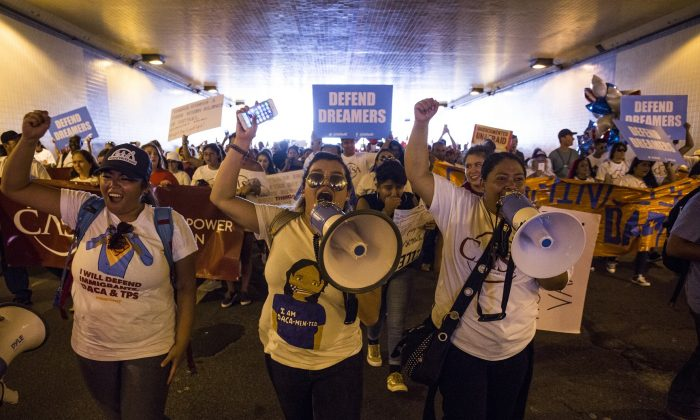 Demonstrators march through a tunnel during a demonstration in response to the Trump Administration's announcement that it would end the Deferred Action for Childhood Arrivals (DACA) program in Washington on Sept. 5, 2017.  (Zach Gibson/Getty Images)