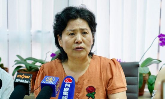Wife of 'Disappeared' Chinese Rights Lawyer Gao Zhisheng to Attend Hong Kong's July 1 Protest
