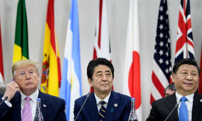 L-R) US President Donald Trump, Japan's Prime Minister Shinzo Abe and China's President Xi Jinping attend a meeting at the G20 Summit in Osaka on June 28, 2019. (BRENDAN SMIALOWSKI/AFP/Getty Images)