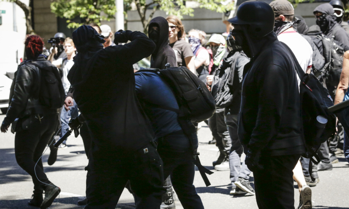 Unidentified Rose City Antifa members beat up Andy Ngo, a Portland-based journalist in Portland, Oregon on June 29, 2019. (Moriah Ratner/Getty Images)