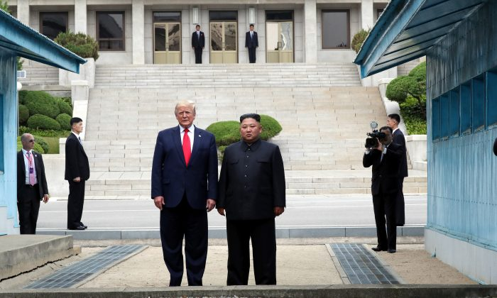 President Donald Trump and North Korean leader Kim Jong Un stand inside the demilitarized zone (DMZ) separating the South and North Korea in Panmunjom, North Korea, on June 30, 2019. (Handout photo by Dong-A Ilbo via Getty Images)