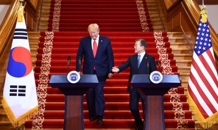 President Donald Trump (L) attends a joint press conference with South Korean President Moon Jae-in at the presidential Blue House in Seoul to confirm meeting with North Korean leader Kim Jong Un at the DMZ on June 30, 2019. (BRENDAN SMIALOWSKI/AFP/Getty Images)