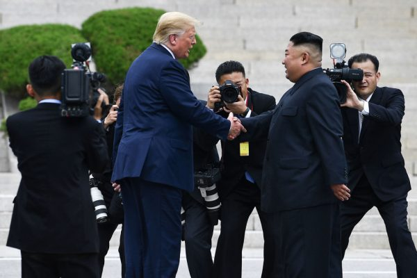 Trump and Ki shake hands