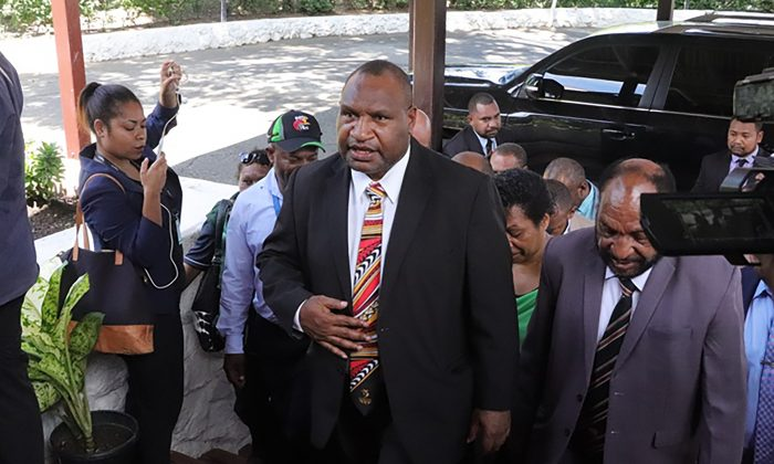 Papua New Guinea's Prime Minister, James Marape (C), arrives at the house of Governor-General Bob Dadae in Port Moresby on May 30, 2019. (GORETHY KENNETH/AFP/Getty Images)