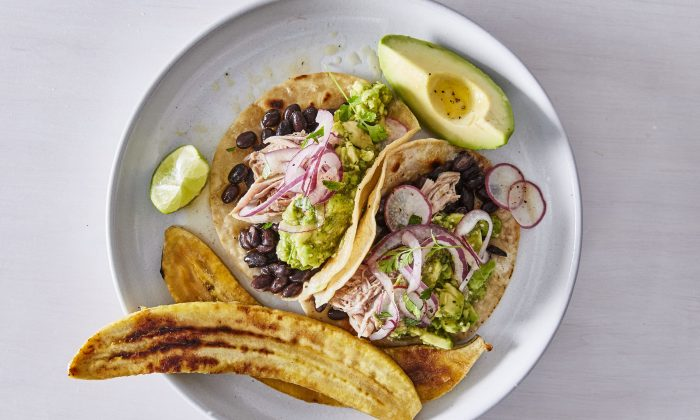 When company arrives, lean on your tried-and-true classics—like Sarah Copeland's pulled pork tacos with tomatillo-lime sauce and plantains. (Gentl + Hyers)