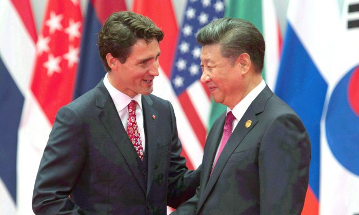 Prime Minister Justin Trudeau and Chinese leader Xi Jinping greet each other during the official welcome at the G20 Leaders Summit in Hangzhou, China, Sept. 4, 2016. (The Canadian Press/Adrian Wyld)