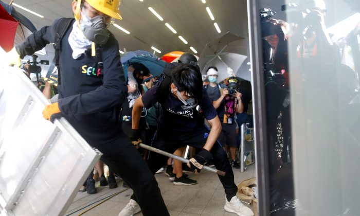 Protesters break into the Legislative Council building during the anniversary of Hong Kong's handover to China in Hong Kong, on July 1, 2019. (Thomas Peter/Reuters)