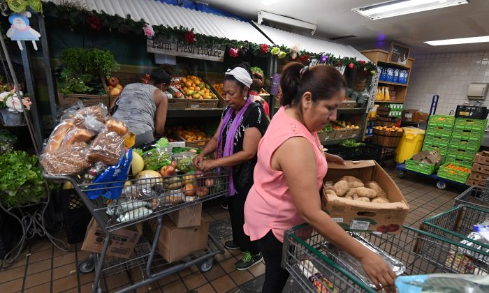 People on low incomes and retirees select food at the World Harvest Food Bank in Los Angeles on July 24, 2019.   (MARK RALSTON/AFP/Getty Images)