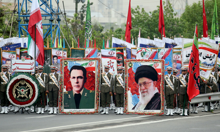 Iranian soldiers hold posters of Iranian Supreme leader Ayatollah Ali Khamenei (R) and former chief of staff of Iranian Army Sepahbod Mohammad-Vali Gharani (L) as they march during a military parade as they mark the country's annual army day in Tehran, on April 18, 2019. (Stringer/AFP/Getty Images)