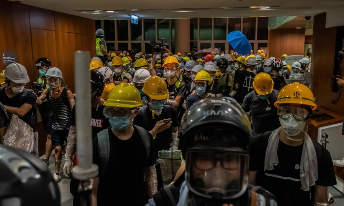 Protesters break into the Legislative Council Complex protest against the extradition bill in Hong Kong, China on July 1, 2019. (Billy H.C. Kwok/Getty Images)