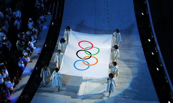 The Olympic flag is seen during the Opening Ceremony of the Turin 2006 Winter Olympic Games on February 10, 2006 at the Olympic Stadium in Turin, Italy. (Clive Rose/Getty Images)