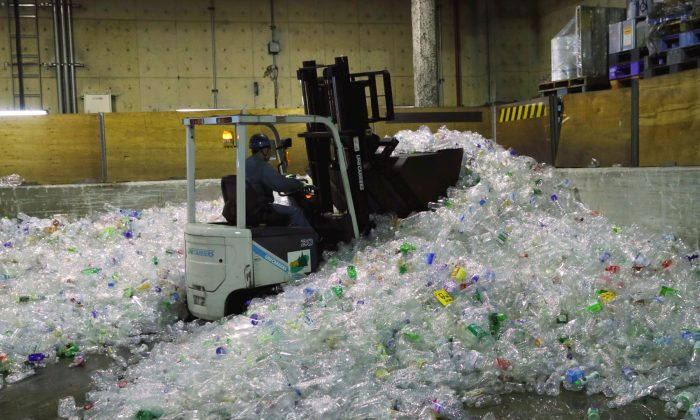 A forklift car carries PET bottles for recycling at Minato Resource Recycle Center in Tokyo, Japan on June 10, 2019. (Kim Kyung-Hoon/Reuters)